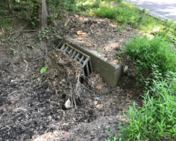 Culvert with dirt in front of entrance