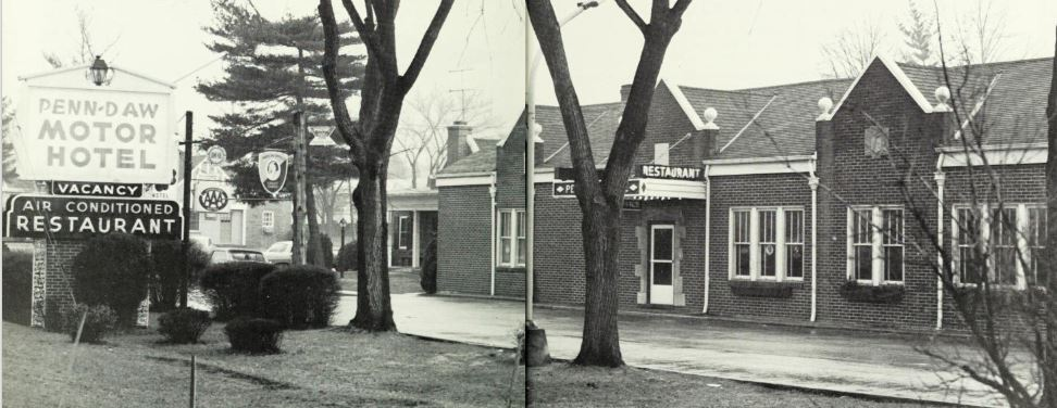 """Black and white picture of the Penn-Daw Motor Hotel, with sign out in front that says name of motel and """"Air Conditioning"""""""