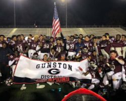 Players gathered together in front of Gunston District Champions banner after the game