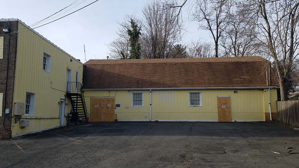 Front of recording studio building with boards over doors