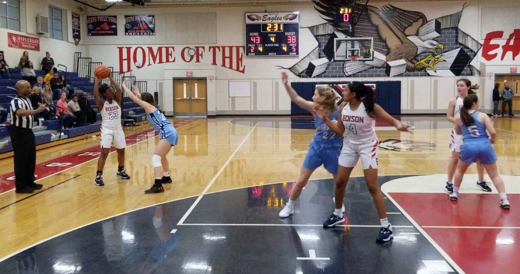 Edison girls basketball player Bri Johns posting up a Marshall player, waiting for a pass