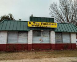 Exterior of 5 Ten Foodmart with blinds closed