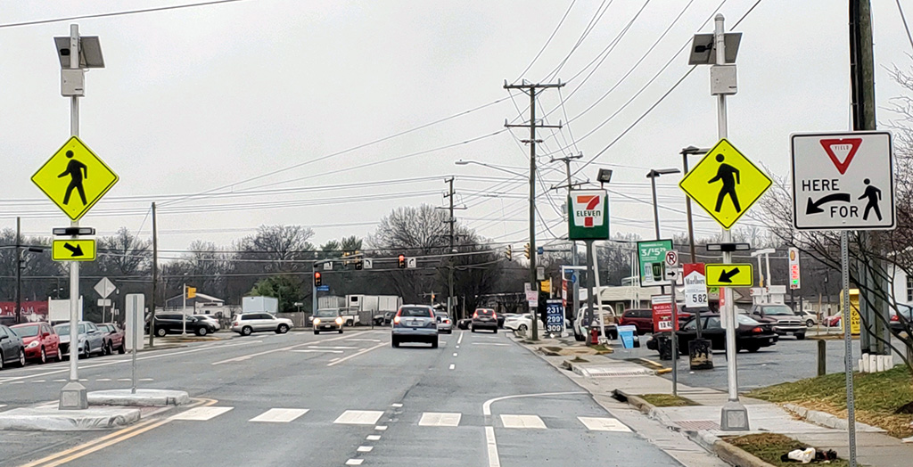 View of new crosswalk with lights and signs visible