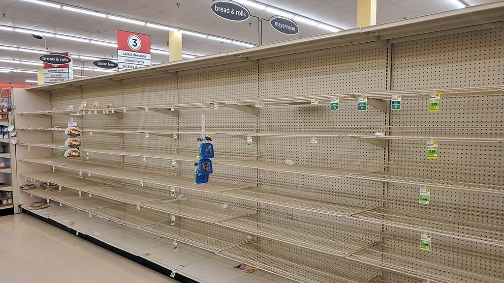 Complete empty shelves in the bread aisle