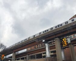 Train going over the Yellow Line bridge near over Huntington Avenue