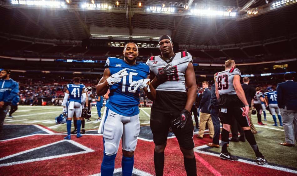 Two players posing in end zone together